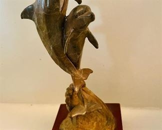 Soapstone carved dolphins statue