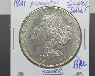 Yr: 1921 - D Denomination Morgan Silver Dollar Located in: Chattanooga, TN D Mint *Coin Grading and Markings on Protective Covers are Not Verified or Certified*  KWM-42