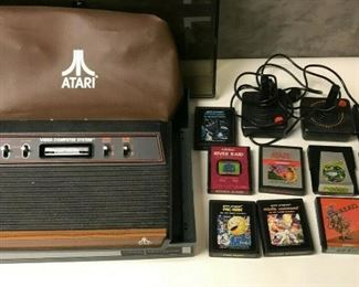 https://www.ebay.com/itm/124658530865BM0100 ATARI GAME SYSTEM WITH 2 JOYSTICKS, CASE, COVER AND 10 GAMES UNTESTED Auction