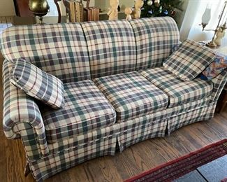 . . . this plaid couch is in excellent condition