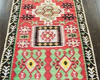 Flat weave rug. Priced at $750.00  5' x 10'                          This item is at the West location.