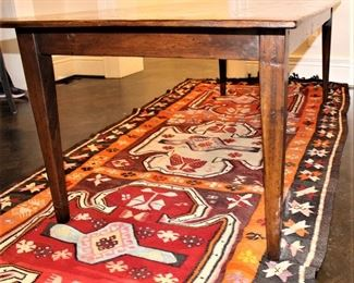 19th century farm house table.                                                              Flat weave rug under table.  1964  Kilim.  $550.00.             5 ft x 11 ft.    These items are at the East location.