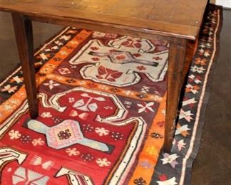 19th century reconstructed farm house table. $2,500.      Flat weave rug under table.  1964  Kilim.  $550.00.             5 ft x 11 ft. These items are at the West location.