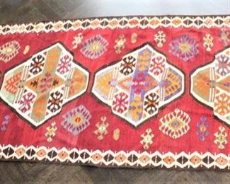 Flat weave rug. $450.00.  4 ft x 9 ft 6 inches.                     This item is at the West location.