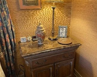 The nightstand has marble top