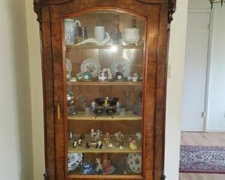 Armoire converted to display cabinet. Walnut veneer over quarter sawn oak. One finial has damage to back side. Key will be held at check out.