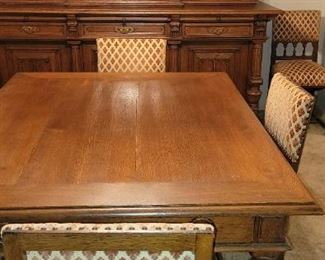 Oak dining table with six chairs. Has been refinished.