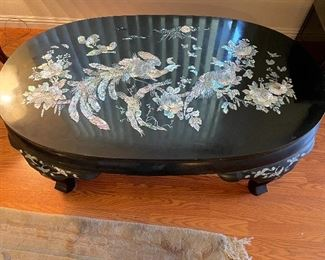 Gorgeous black lacquer and mother of pearl inlayed oval coffee table in excellent condition $600.00