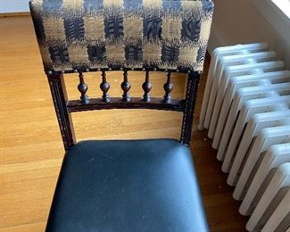 Closer view of the chairs - leather is Holly Hunt and is black.