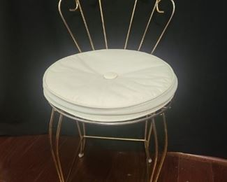 "Metal shellback decorative vanity chair. Chair has a white cushion though it can be easily replaced of you want a different look. Measures 12"" x 12"" x 27"". https://ctbids.com/#!/description/share/821785"
