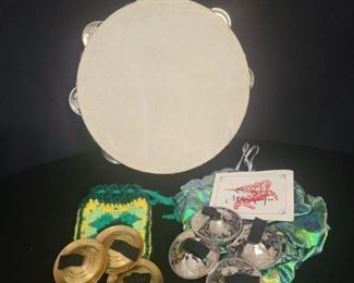 Set of beautifully crafted and etched zill made by Saroyan master-crafts and a set of gold zills. Each pair comes with a storage bag and are in good condition Tambourine is made with real animal hide and in good condition. https://ctbids.com/#!/description/share/821782