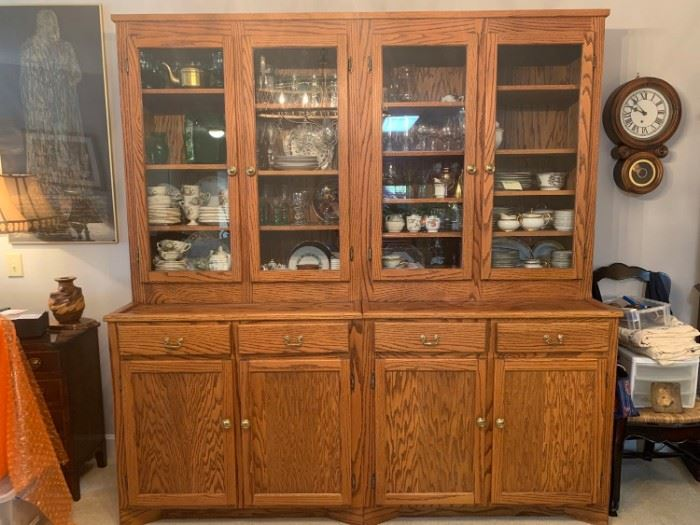 "China cabinet custom made from oak wood that has been accented with glass panels, brass knobs and handles. The piece is sectional and designed to separate in the middle. There are a couple of water spots but over all the condition of the cabinet is great. Nothing in the cabinets are included just the cabinets are for sale. 81x25x84"". https://ctbids.com/#!/description/share/821737"