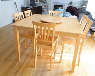 Tall Bistro style Kitchen/Dining Table leaf inside and 6 chairs - maple - $275 lazy Susan included.