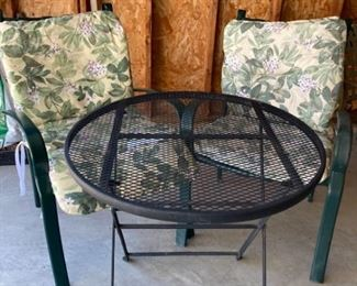 Two Patio Chairs and Wrought Iron Table