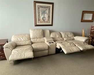 Beautiful Leather sectional couch, can be arranged into 3 different pieces.