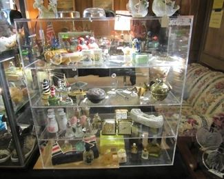 Sterling Salt & Peppers plus Colognes and Perfumes with  an assortment of collectible knickknacks.