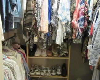 Ladies clothing and shoes galore, assorted sizes.