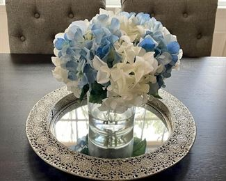 "Item 14:  Mirrored Tray with Metal Reticulated Edge - 16"":   $14                                                                                                            Item 15:  Faux Blue and White Flowers in Clear Glass - 10"": $14"