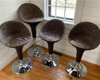 "Item 18:  (2) Rattan Bar Stools, adjustable height and chrome bases -16""l x 12.5""w x 31.5"":  $75 ea (TWO SOLD)"