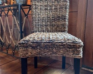 "Item 41:  (2) Woven Wicker Chairs - 19""l x 17.25""w x 39.5""h:  $115 each"