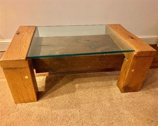 $175 - Hand crafted glass top coffee table with reclaimed wood supports -  35 in. W x 14 in. H x 21 in. deep