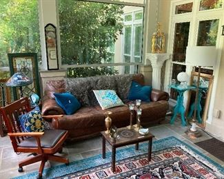 Leather sofa, corved coffee table, leaded glass windows, Tiffany-style lamp