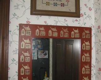 """Stenciled mirror and cross-stitch """"Home Sweet Home"""""""
