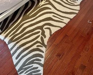 """Item 48:  Zebra Rug - 98"""" x 49.5"""" (this item shows signs of wear):  $28"""