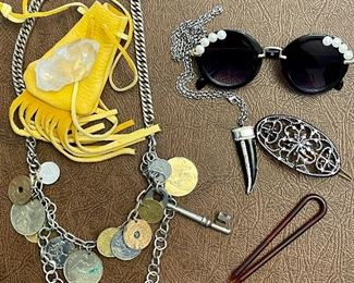Item 182:  Lot 8 Costume Jewelry - quartz rock in yellow bag, barrettes, coin necklace, glasses and pendant: $14