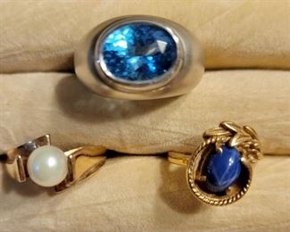 Item 163:  14K Gold and Topaz Ring (top):  $525  Item 164:  10K Gold and Pearl Ring (2nd row left):  $145                                                                                                         Item 165:  14K Gold and Star Sapphire Ring (2nd row right):  $225(SOLD)