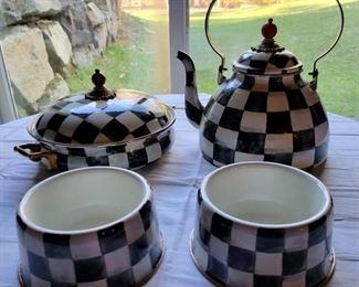 Item 213:  MacKenzie Childs Covered Casserole (back row left): $110                                                                                                                     Item 214:  MacKenzie Childs Teapot (back row right): $115                                                                                                          Item 215:  (2) MacKenzie Childs Dog Dishes (front row): $45 each