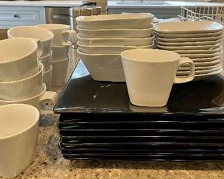 Item 274:  (11) Crate and Barrel Kahla Germany Cups: $45    (8) Black West Elm Plates: $32. (5) Crate and Barrel Kahla Germany Bowls: $38  (12) small bread plates by Crate and Barrel Kahla Germany:  $48