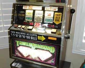 Triple Diamond (IGT) quarter slot machine. It must be working fine, because it took $100 from us today, like all one arm bandits do!
