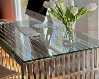 Desk- Stainless steel base with a thick glass top