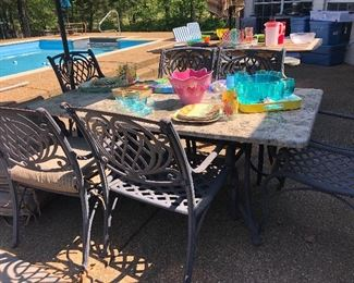 Patio table-stone top with 6 iron chairs