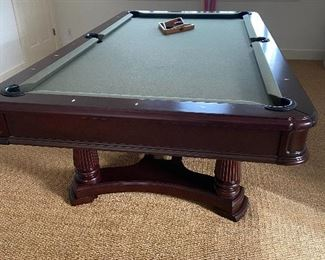 Brunswick Pool Table with coordinating wall rack for cues and accessories.  $2200