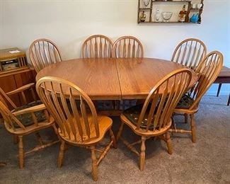 Solid Oak Dining Table with 4 leaves and 8 chairs (2 captain's chairs)