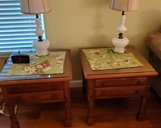 two matching nightstands and milk glass lamps