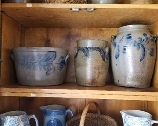 Cobalt decorated salt glaze stoneware including milk pan (middle shelf, far left)