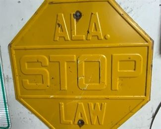 Vintage heavy metal embossed Alabama stop sign