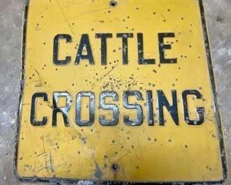 Vintage heavy metal embossed cattle crossing sign
