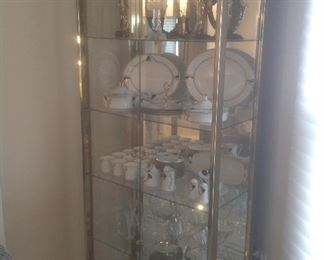 """Beautiful brass and glass display cabinet. Measures 32"""" wide x 75"""" T x 17"""" d.  Presale $375"""