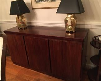 Rosewood credenza, very fine, from Scan.  Left third is furnished with shallow drawers lined with tarnish prevention green felt.  Right doors open to large cupboard with one shelf.  Slight white moisture spot is just to the right of the center, otherwise perfect.  $950