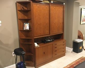 Walnut wall system has free standing triangular side pieces that you can opt out of using.  Sliding upper doors reveal adjustable shelves.  Also has a matching bookcase that is hutch style and can be inserted.   $$500