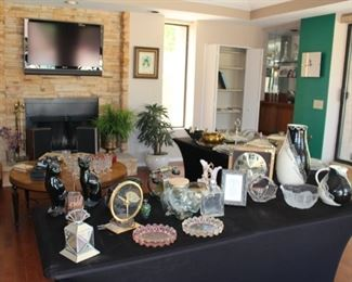 Plenty of collectible glass, vintage phones and clocks, Native pottery, all flat screens are for sale as well