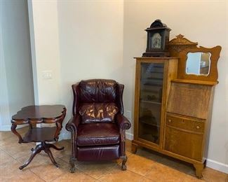 Leather inlay scalloped table, leather recliner, antique clock, display case