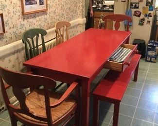 Red farm table, bench and 4 chairs