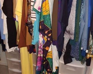 Huge amount of dresses .T shirts,pants you name it--' size large to extra large Boxes of sweatshirts. All clean and folded