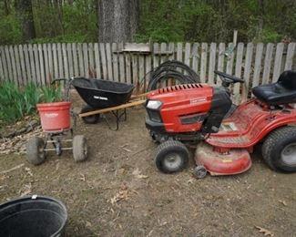 Seeder/fertilizer, mower (sold), wheel barrow