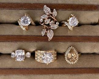 $20 each white rhinestone or cubic zirconium gold tone rings